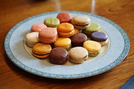 A plate of colourful French macarons