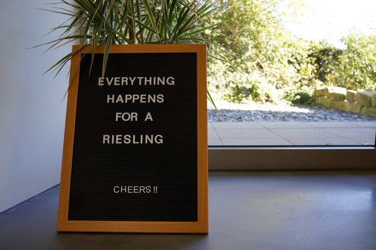 """Sign saying """"Everything happens for a Riesling"""""""