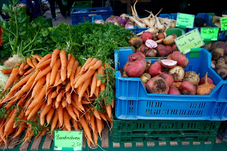 Carrots and beetroots in crates at the Wiesbaden farmers' market