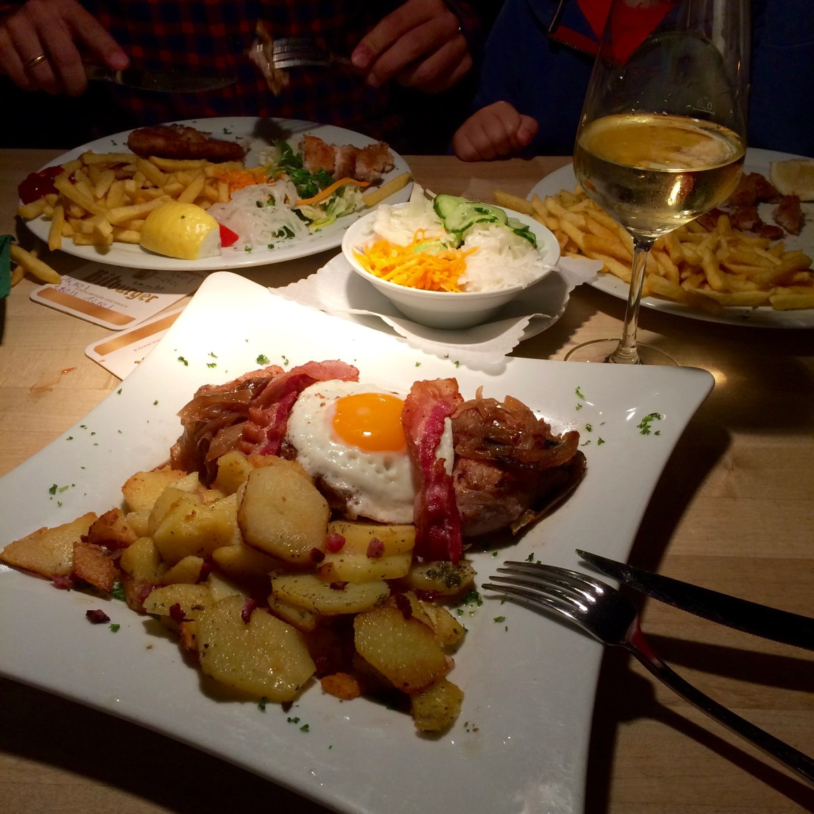 Plates of pork and potatoes in a German pub