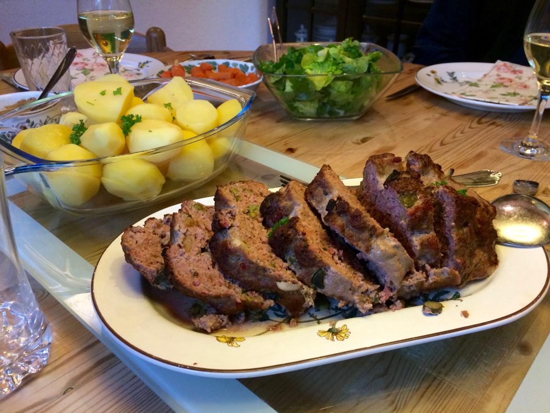 A sliced German meatloaf (Hackbraten)