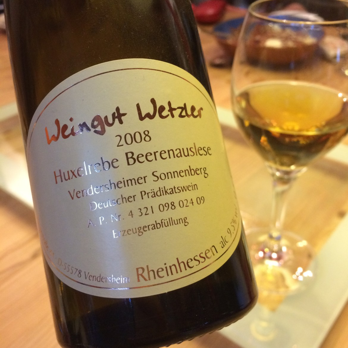 A bottle of Huxelrebe Beerenauslese Wine Weingut Wetzler and glass