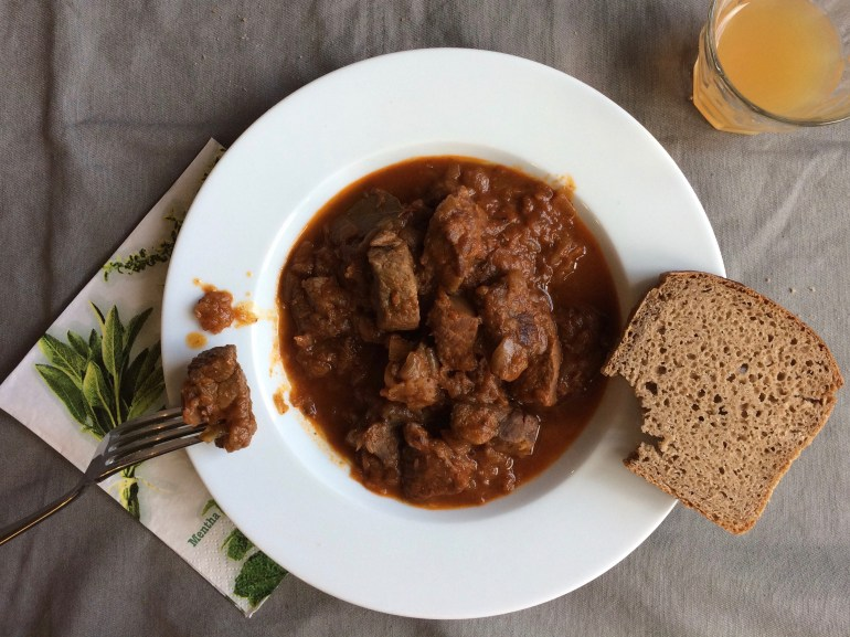 Close up from above of Gulasch with bread
