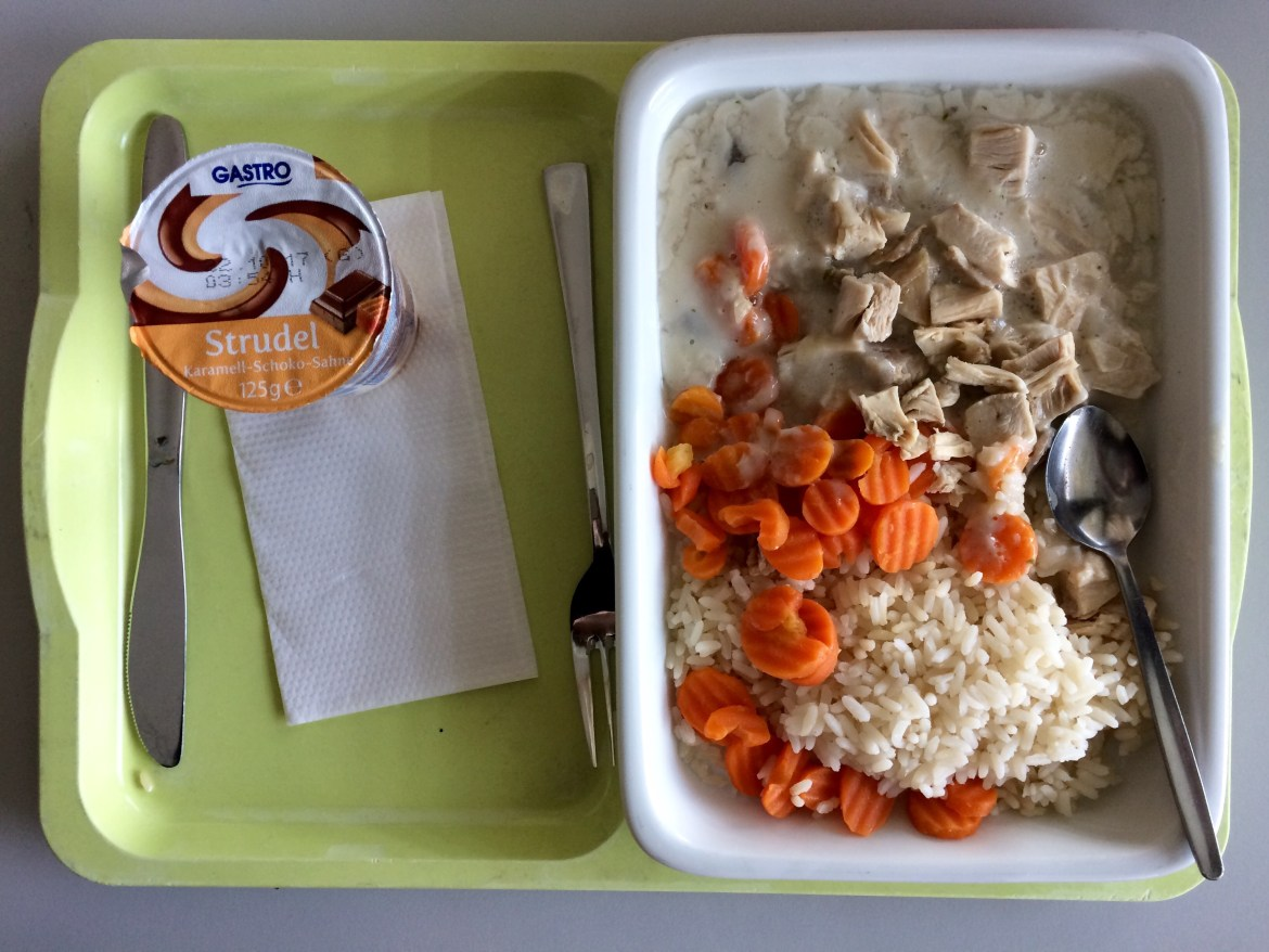 German hospital food on a tray including chicken fricassee with carrots