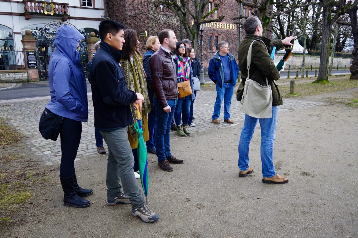 A group of people standing outside together on a Mainz food and wine tour