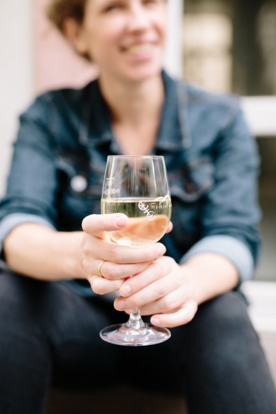 Portrait of Christie Dietz with a glass of white wine