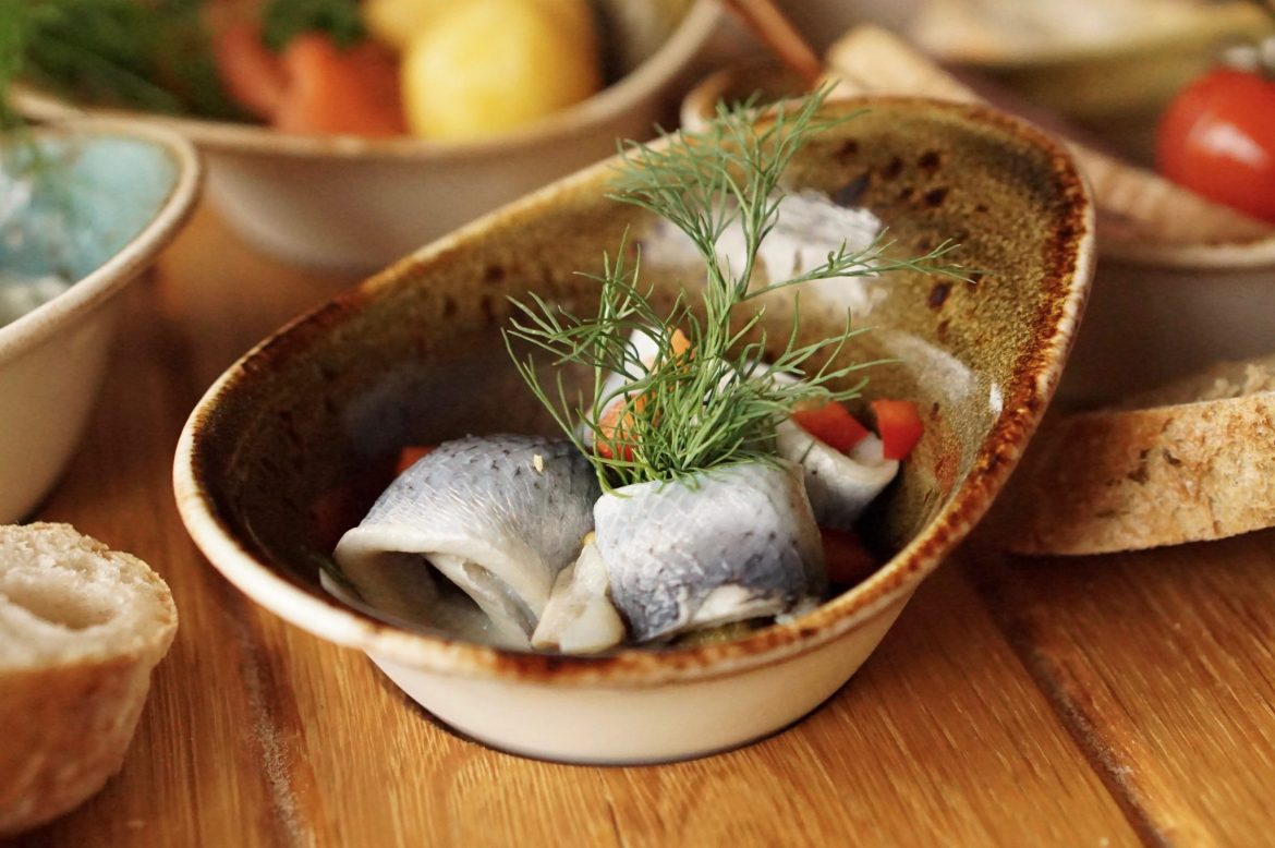 Rollmops in a small brown bowl
