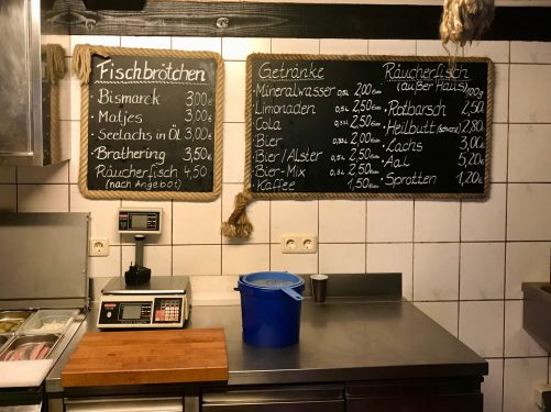 Blackboards with sandwich fillings written in German in white chalk