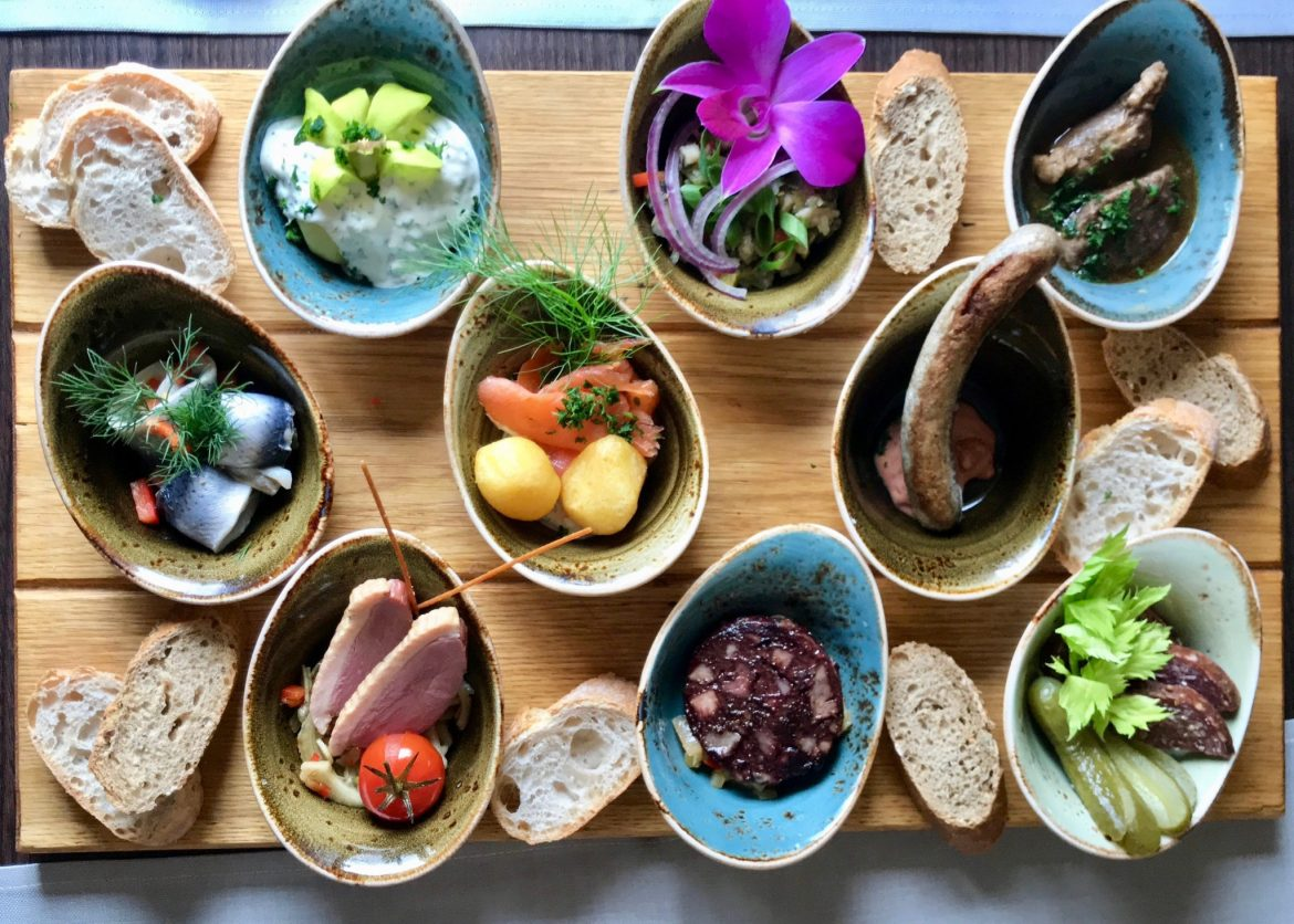 Colourful flat lay of tapas-style local specialties at Restaurant Remise on Usedom, Germany