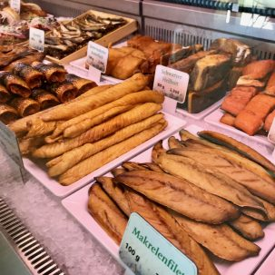 A selection of smoked fish in a glass counter