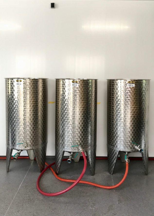 Three metal tanks
