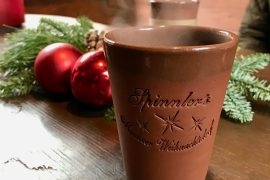 A terracotta mug of steaming mulled wine