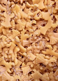 A huge pile of beeswax Christmas decorations in the shape of angels