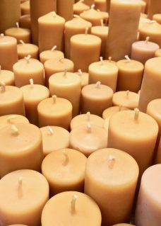 A cluster of yellow beeswax candles