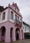 The pink Walderdorff Residence, opposite the cathedral