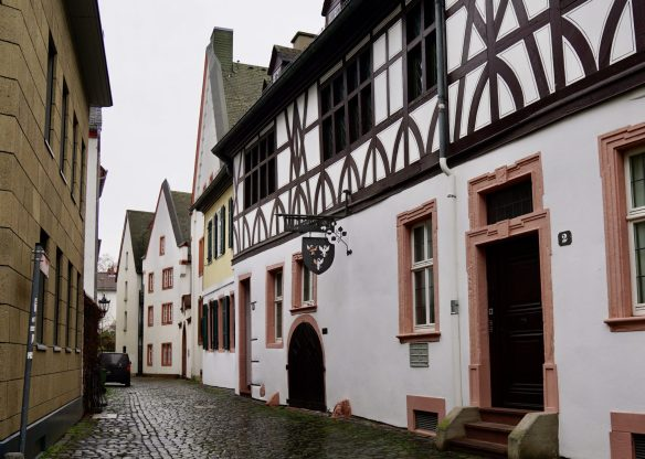 Half-timbered houses on a narrow street on a grey day