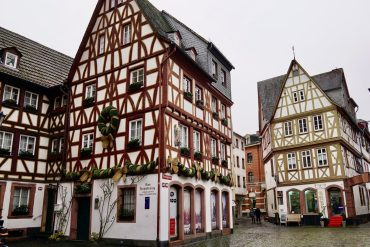 Half-timbered buildings covered in Christmas lights