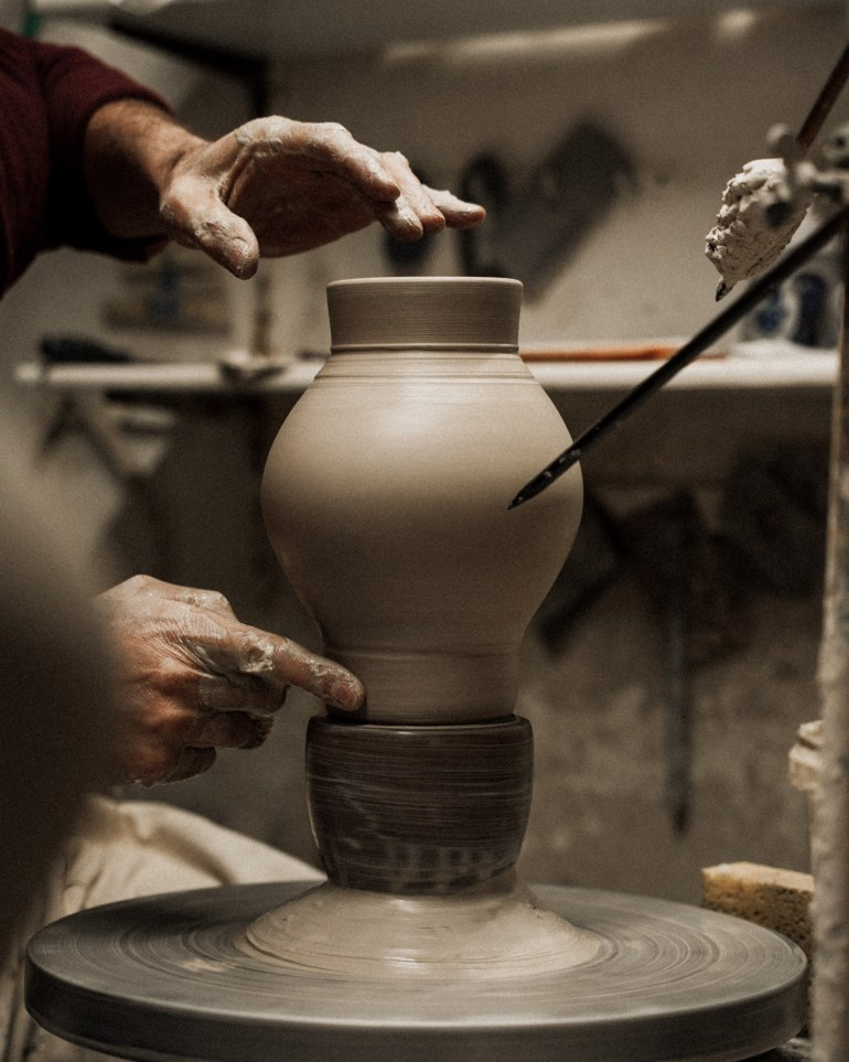 A Bembel being formed on a pottery wheel