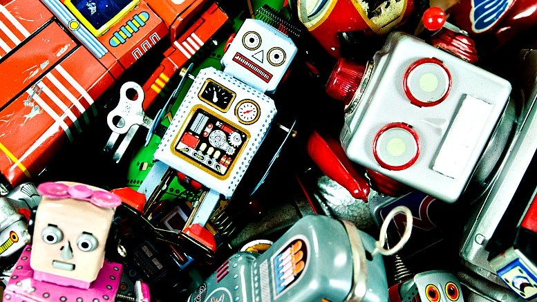 A pile of old tin toy robots
