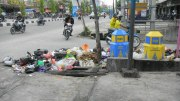 A heap of plastic waste at the side of a road in Indonesia