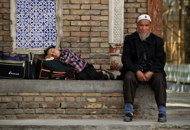 Uyghurs sitting outside a Mosque in Shache, Xinjiang province.