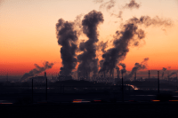 Coal fired power plants spew smoke into the atmosphere