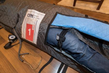 CVN Arctic Pallas Hypothermia Bag treatment pockets can be used to treat and exam the lower limbs.
