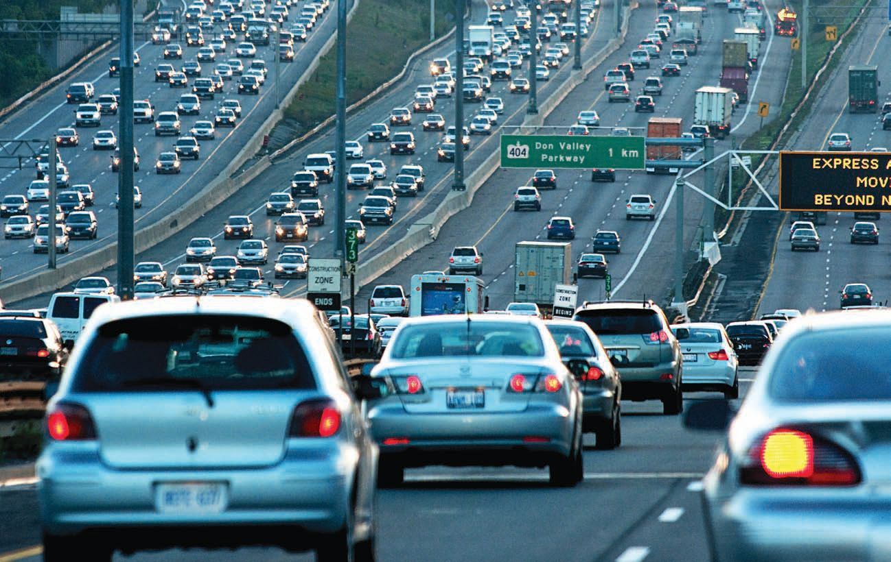Vehicles driving on a crowded freeway.