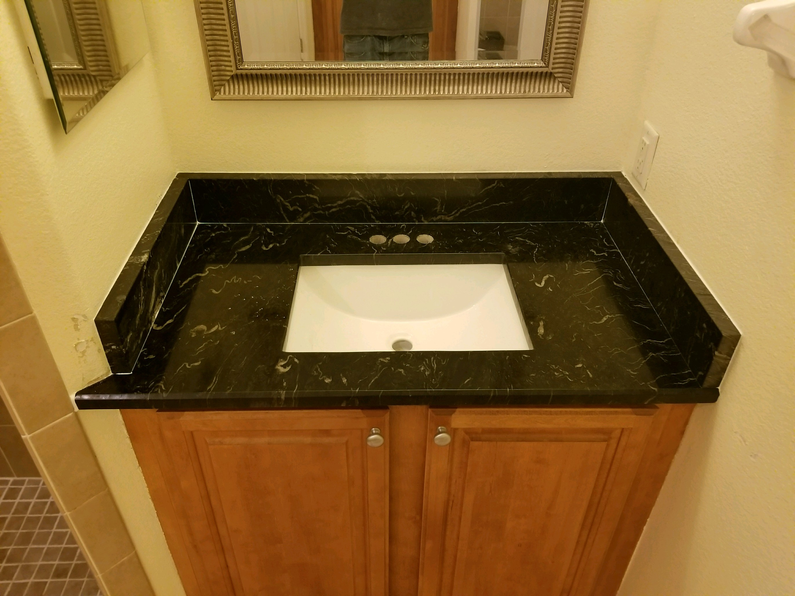 Titanium Black Granite Bathroom Countertops Remodel In Clearwater Fl - Bathroom countertop remodel