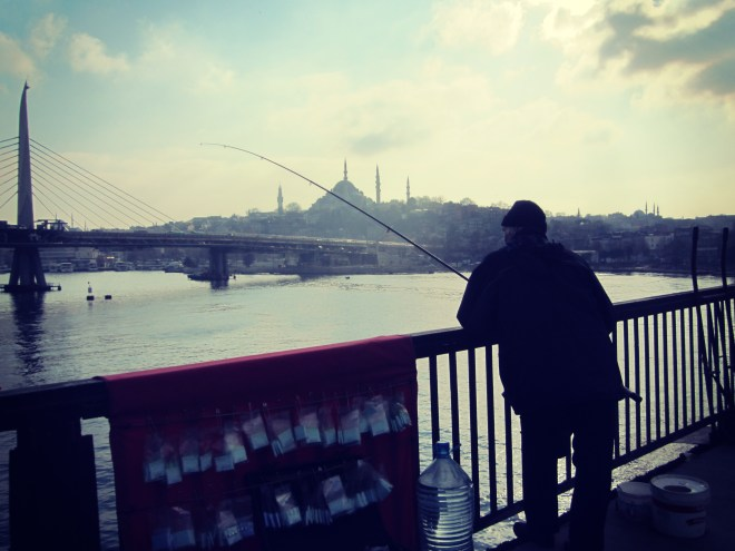 A man on the bridge in Istanbul at Christmas
