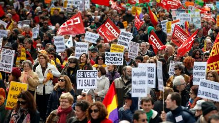 People march during a protest against government austerity measures in Madrid