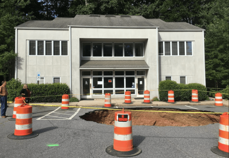 Building Next To Merrimon Avenue Sinkhole Posted As Unsafe