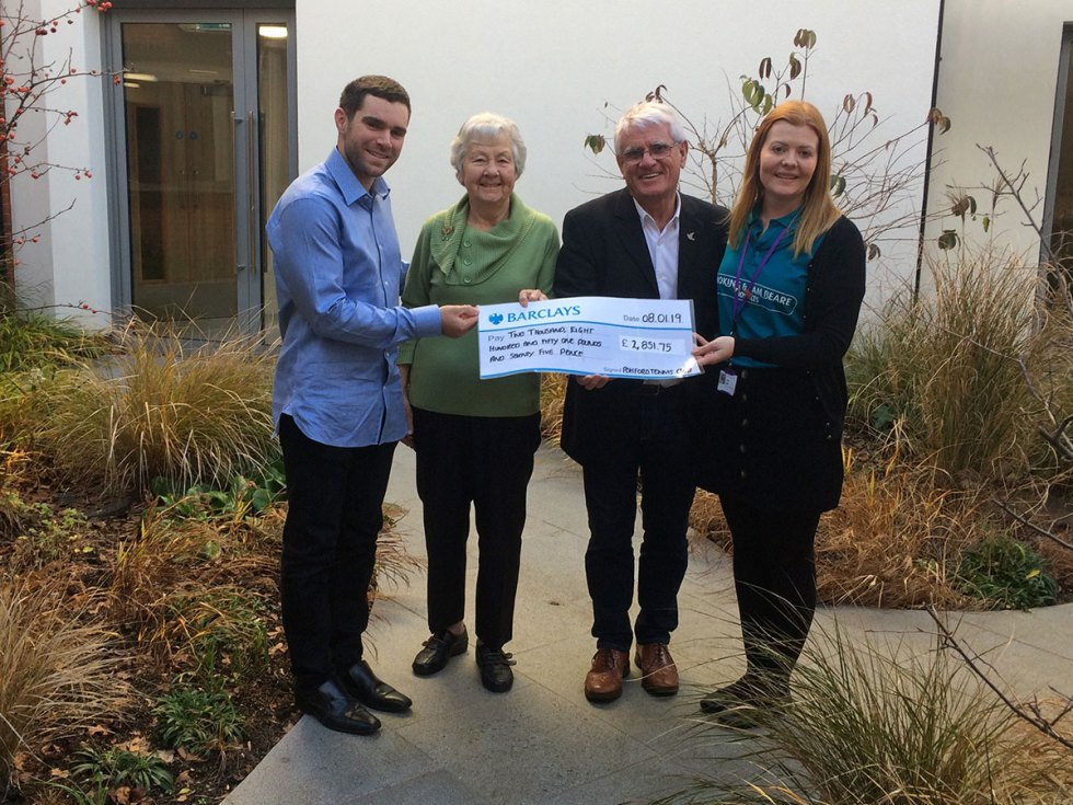 Ashford Tennis club present a cheque to the Sam Beare Hospice in Woking