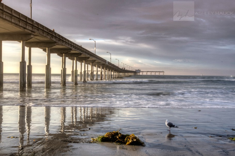 San Diego, California: Sunset and waves at the municipal fishing pier in Ocean Beach.