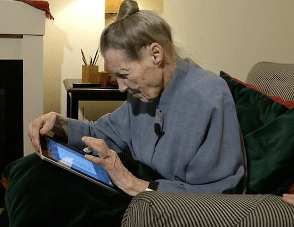 Elderly woman using a tablet