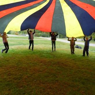 Under the parachute.
