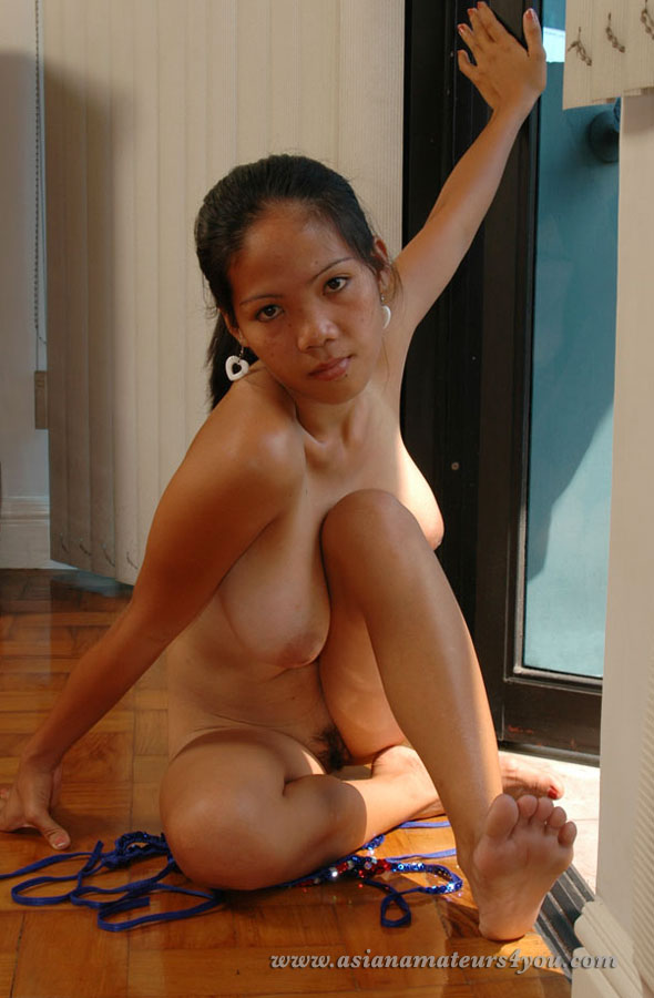 Voluptous Filipina woman shows her melons and nipples