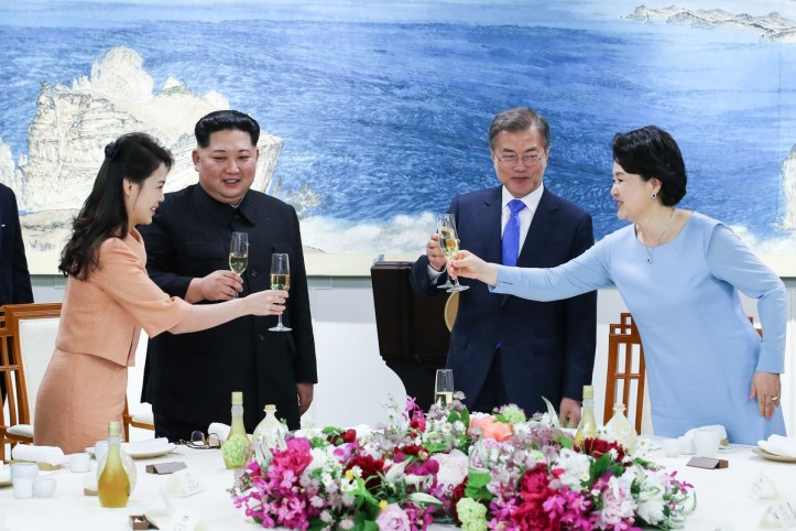 North Korea's leader Kim Jong Un (2nd L) and his wife Ri Sol Ju (L) toast with South Korea's President Moon Jae-in (2nd R) and his wife Kim Jung-sook (R) during the official dinner at the end of their historic summit at the truce village of Panmunjom on April 27, 2018.