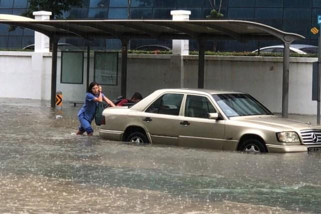 Singaporean pushing car