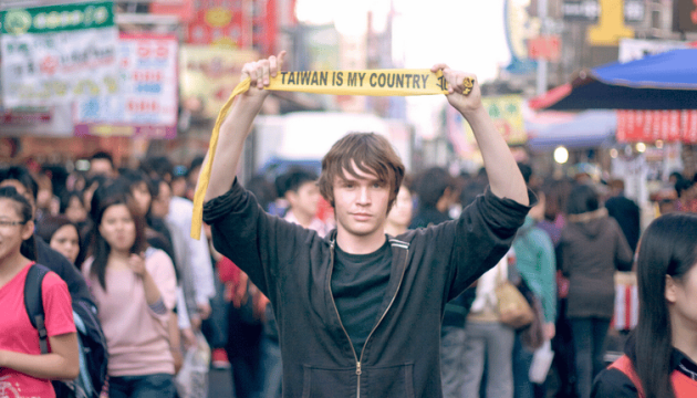 Man with 'Taiwan is my country' Credit: Peter Kwak