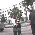 복장이나 풍기문란을 단속하는 규찰대의 검열에 걸린 젊은 여성들. 2008년 10월 황해남도 해주시에서. 심의천 촬영(아시아프레스)