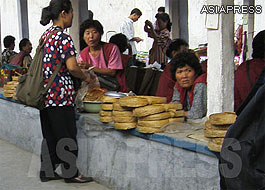 "Women selling half-dried coils of ""artificial meat"" at the authorized public market. (Kandong County, Pyongyang. September 2008. Taken by Chang Jeong-gil) ASIAPRESS"