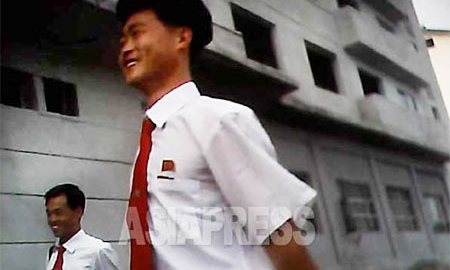 Two university students in the standard white shirt and red tie. Pinned to their chest a red badge of the North Korean leaders and the school seal. (Photo taken in a regional city in North Korea. June, 2013) ASIAPRESS