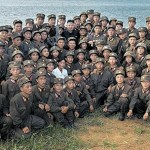 Soldiers of units posted at the West-South Front facing South Korea. Careful observation of the young soldiers in the picture confirms that most appear frail. (Source. Rodong Sinmun. Aug/2012)