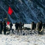 A group of women mobilized for compost collection on a bitterly cold winter's day. (Taken by Kim Dong-cheol, in the middle region of North Korea. Mid-January. 2015) ASIAPRESS