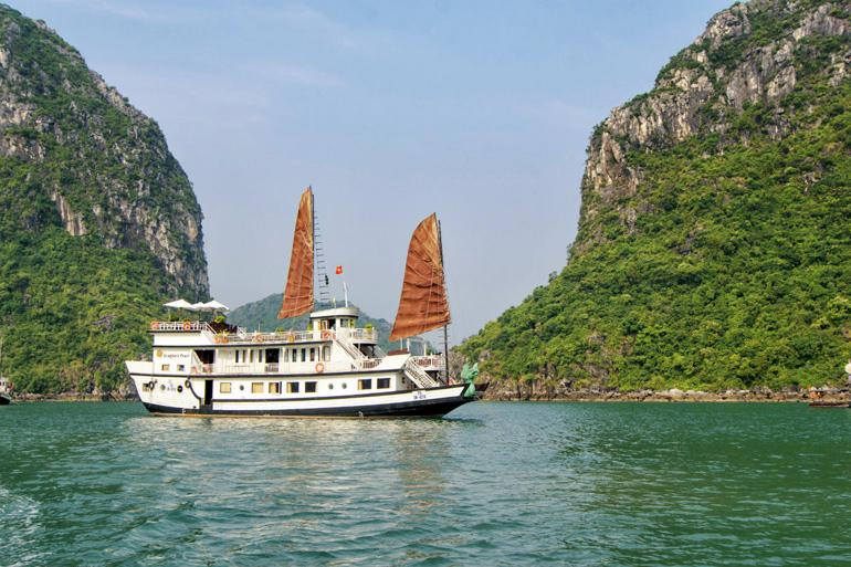 Aboard the Dragon's Pearl, journey through the mysterious and beautiful Ha Long Bay in Vietnam.