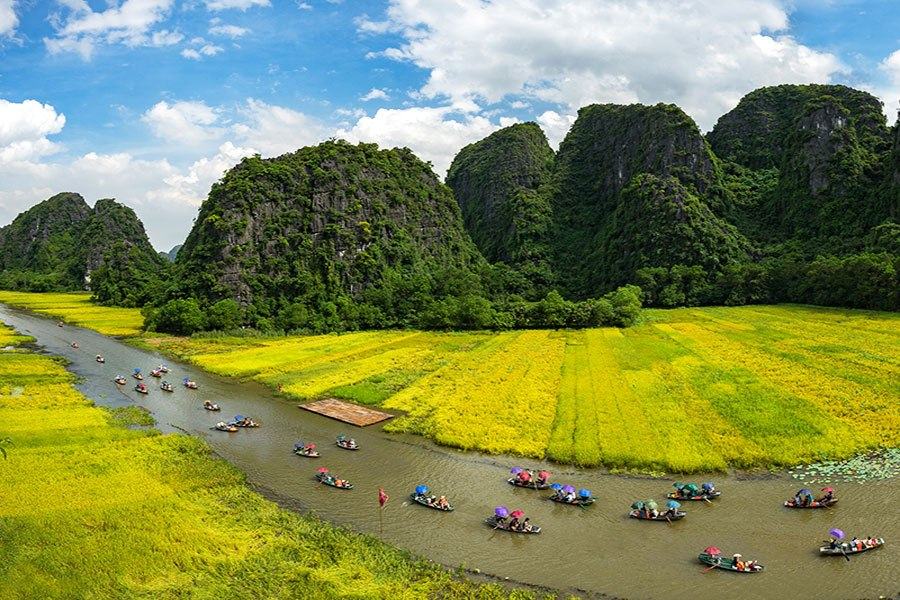 Tourists visit Trang An