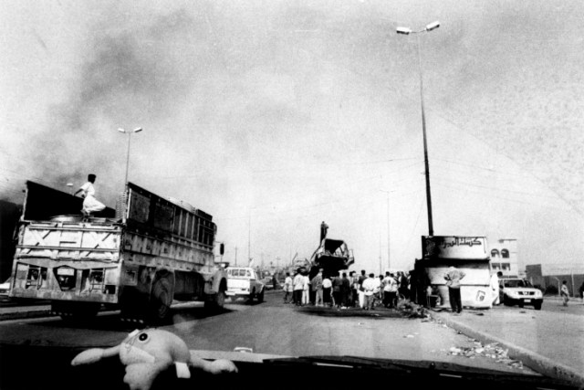 Iraq, Fallujah, people gathered on road (B&W)