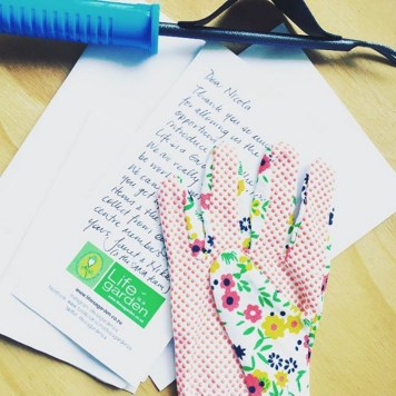 The cute gloves, tool and handwritten note from Life is a Garden