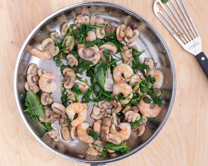 shrimp added to pan with spinach and mushrooms